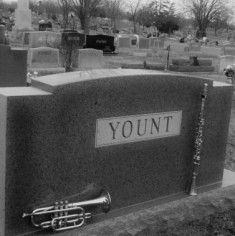 """Sitting on Top of My Dad's Tombstone"" — a poem by Alan Yount"